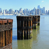 Old piers.  NYC in background