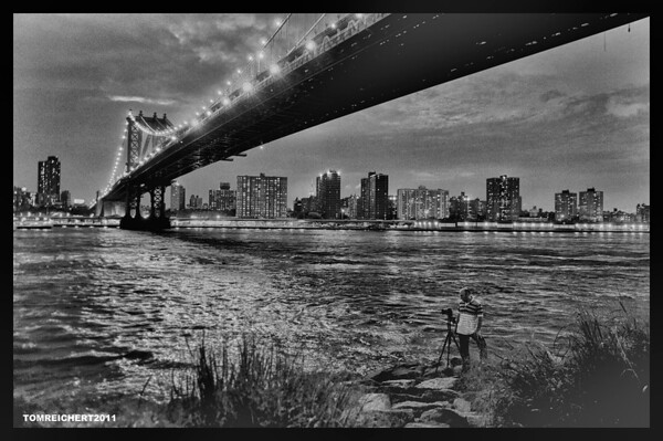 A PHOTOGRAPHER UNDER THE MANHATTAN BRIDGE